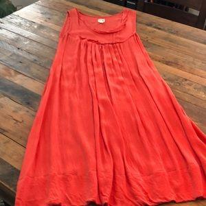 Salmon color slip dress.